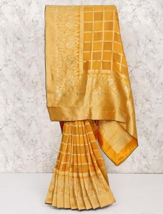 Yellow wedding silk saree in checks pattern