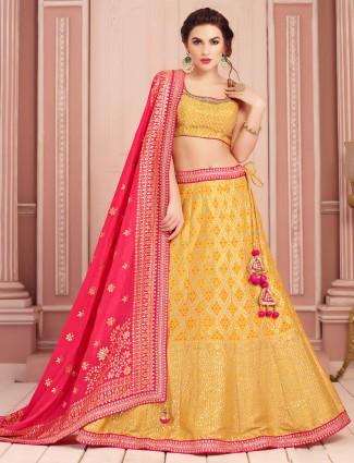 Yellow wedding wear lehenga choli in silk
